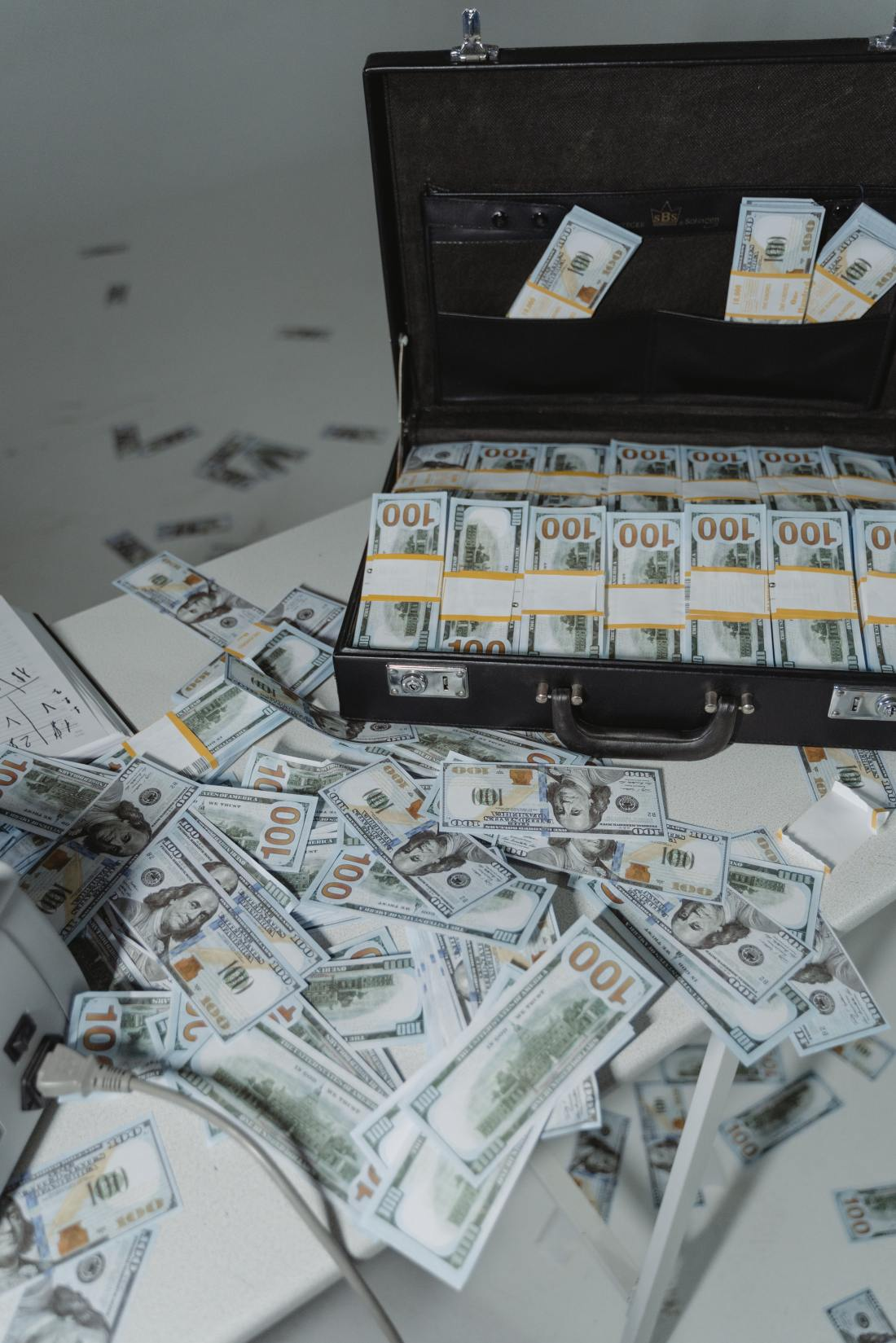 Cash sloppily thrown about suitcase